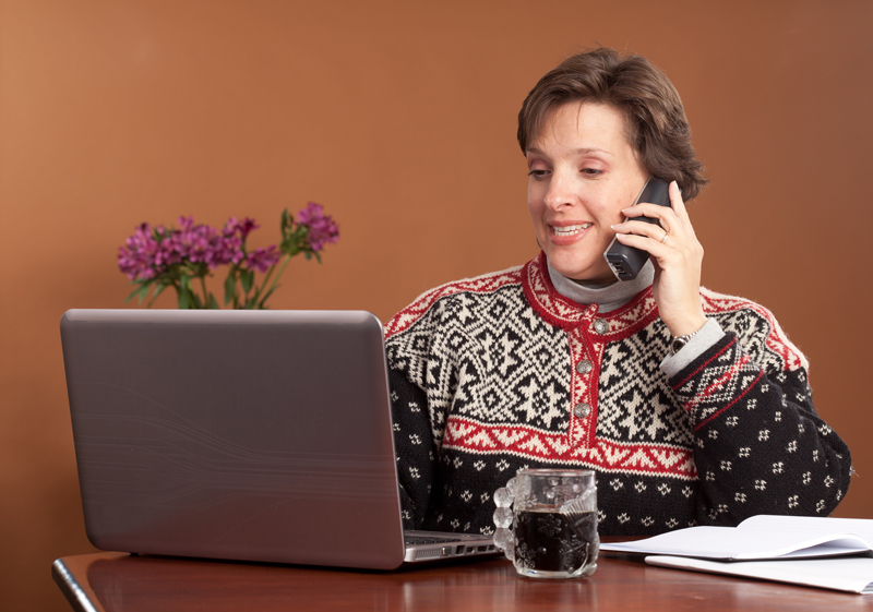 bigstock-Attractive-woman-working-at-ho-29298176
